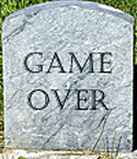 tombstone that reads Game Over
